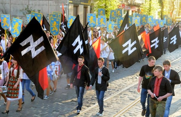 Supporters of the Ukrainian nationalist movement rally in downtown Lviv on April 28, 2012 to mark the 68th anniversary of the formation of the Ukrainian Galacian Division of the Waffen SS. AFP PHOTO / YURIY DYACHYSHYN